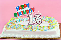Birthday Cake with Number 13 Lit Candles Royalty Free Stock Images