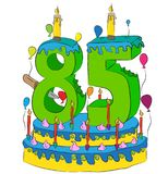85 Birthday Cake With Number Eighty Five Candle, Celebrating Eighty-Fifth Year of Life, Colorful Balloons and Chocolate Coating Stock Photo