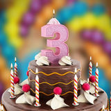 Birthday cake with number 3 lit candle Stock Photography