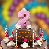 Birthday cake with number 2 lit candle Royalty Free Stock Photography