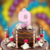 Birthday cake with number 9 lit candle Royalty Free Stock Photography