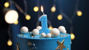 Birthday cake number 1 stars sky and moon concept, blue candle is fire by lighter and then blows out. Copy space on