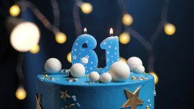 Birthday cake number 61 stars sky and moon concept, blue candle is fire by lighter and then blows out. Copy space on