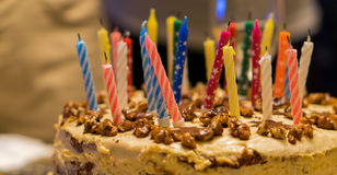 Birthday cake with nuts and candles Royalty Free Stock Photo