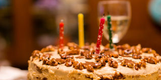 Birthday cake with nuts and candles Royalty Free Stock Image