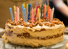 Birthday cake with nuts and candles Royalty Free Stock Images