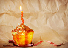 Birthday cake with one burning candle Royalty Free Stock Images