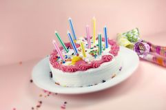 Birthday Cake and Party Blowers Royalty Free Stock Photos