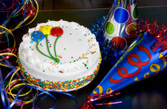 Birthday Cake and Party Hats Stock Photos