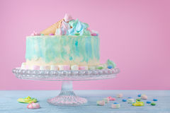 Birthday cake in pastel colors, marshmallow and candies on pink background, selective focus stock photos