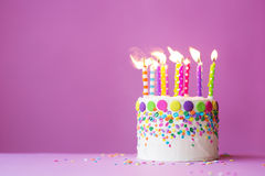 Birthday cake. On a pink background Stock Photos