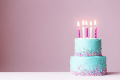 Birthday cake with pink candles. Tiered birthday cake with pink candles Stock Photo