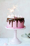 Birthday cake. Pink birthday cake with sparklers royalty free stock images