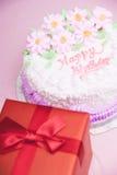 Birthday cake and present box Stock Photos