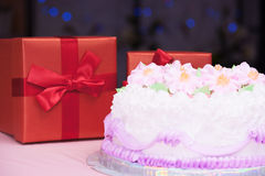 Birthday cake and present box Stock Images