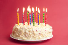 Birthday cake on red background Stock Photo