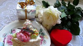 Birthday cake, roses flowers and gifts stock video