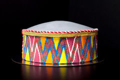 Birthday cake (shape like a hat) with mastic and pattern on blac Stock Images