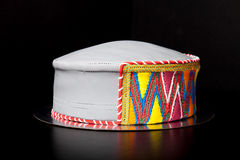 Birthday cake shape like a hat with mastic and pattern on blac Stock Photo