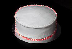 Birthday cake shape like a hat with mastic and pattern on blac Stock Image