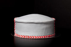 Birthday cake shape like a hat with mastic and pattern on blac Royalty Free Stock Image