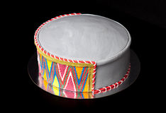 Birthday cake shape like a hat with mastic and pattern on blac Royalty Free Stock Photos