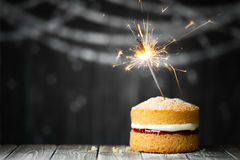 Birthday cake with sparkler Stock Images