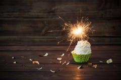 Birthday cake with sparkler on  wooden background stock photo