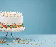 Birthday Cake with Sprinkles over blue Royalty Free Stock Image