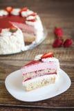 Birthday cake with strawberries and cream roses. Birthday cake with fresh strawberries and white cream roses on wood background Stock Photo