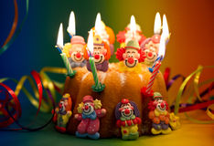 Birthday cake with sugar clown decoration. And candles. selective focus royalty free stock photo