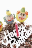 Birthday cake with sugar clowns, close-up Royalty Free Stock Image