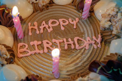 Birthday cake. Text happy birthday on cake with candles Royalty Free Stock Photos