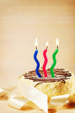 Birthday cake with three burning candles Stock Photos