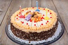 Birthday cake and three candles Royalty Free Stock Photos