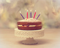Birthday Cake. Victoria sponge Birthday cake with lit candles - antique vintage tone effect added Stock Photography
