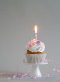 Birthday cake with whipped cream and flowers Stock Photo