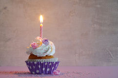 Birthday cake with whipped cream and flowers Stock Image
