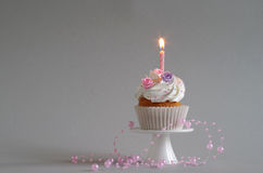 Birthday cake with whipped cream and flowers Royalty Free Stock Photo