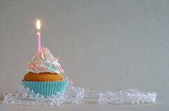 Birthday cake with whipped cream and sugar sprinkles Royalty Free Stock Photos
