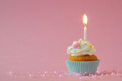 Birthday cake with whipped cream and sugar sprinkles Stock Photos