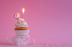 Birthday cake with whipped cream and sugar sprinkles Royalty Free Stock Image