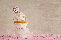 Birthday cake with whipped cream and sugar sprinkles Royalty Free Stock Photography