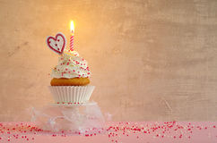 Birthday cake with whipped cream and sugar sprinkles Stock Photography