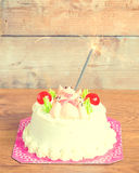 Birthday cake on wooden background Stock Image