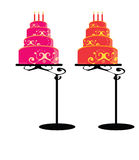 Birthday cakes on stands isolated Stock Images