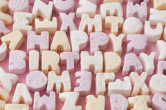Birthday Candies. Letter candies spelling out the words Happy Birthday Stock Photography