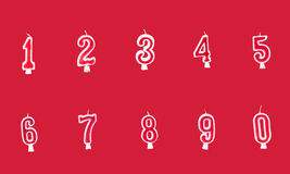 Birthday candle. Numeral birthday candles on red background Stock Photography