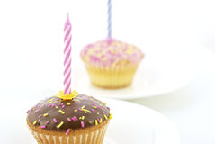 Birthday candle and chocolate muffin. S isolated on white background Stock Images