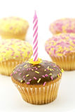Birthday candle and chocolate muffins Stock Photos